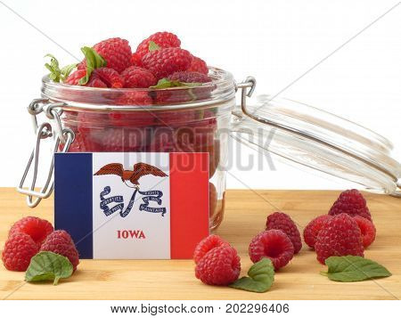 Iowa Flag On A Wooden Panel With Raspberries Isolated On A White Background