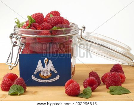 Louisiana Flag On A Wooden Panel With Raspberries Isolated On A White Background