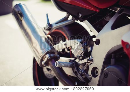 Metal Motorcycle Exhaust Pipe And Other Parts Of The Motorcycle