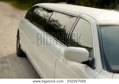 White Wedding Limousine Stands On The Street