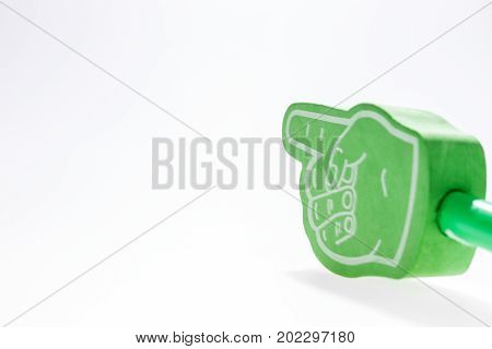 Green hand with extended index finger isolated on white