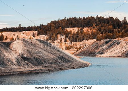 Landscape. Clay quarry for the extraction of clay. mountain of clay, cinder, coal