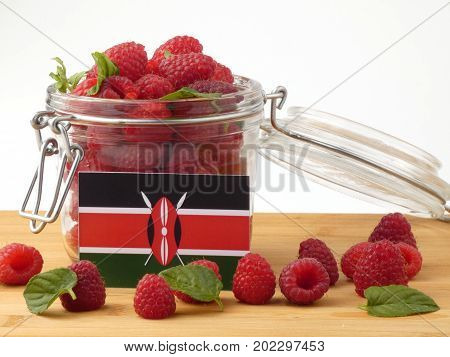Kenyan Flag On A Wooden Panel With Raspberries Isolated On A White Background