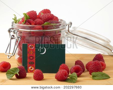 Turkmenistan Flag On A Wooden Panel With Raspberries Isolated On A White Background