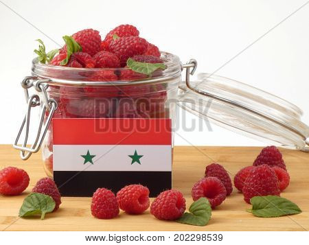 Syria Flag On A Wooden Panel With Raspberries Isolated On A White Background
