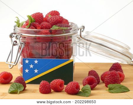 Solomon Islands Flag On A Wooden Panel With Raspberries Isolated On A White Background