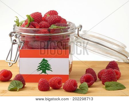 Lebanese Flag On A Wooden Panel With Raspberries Isolated On A White Background