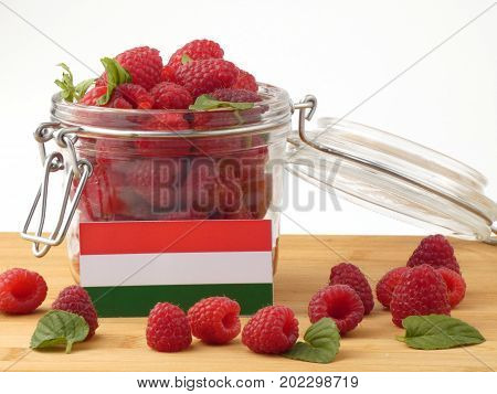Hungarian Flag On A Wooden Panel With Raspberries Isolated On A White Background