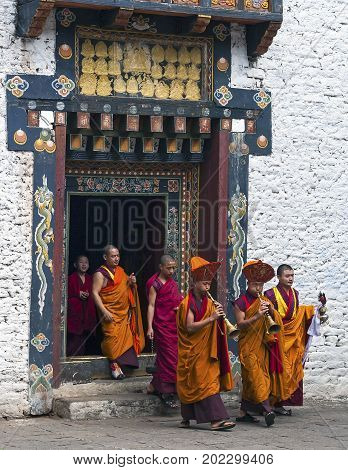 TRASHIGANG, BHUTAN - OCTOBER, 22, 2010 : Monk ritual in Trashigang dzong. Monks are getting out the dzong to proceed for the ceremony.