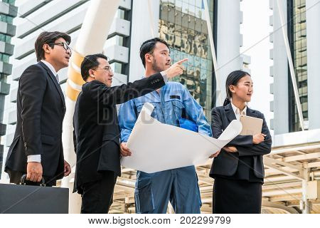 Group of engineer businessman and businesswoman working in construction business. Concept of teamwork success construction project of engineering business people.