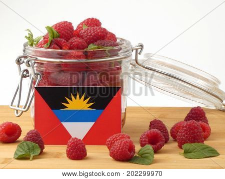 Antigua And Barbuda Flag On A Wooden Panel With Raspberries Isolated On A White Background