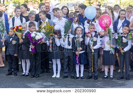 Adygea Russia - September 1 2017: Children enrolled in the first grade at school with teachers and parents at the inauguration of the school year in the day of knowledge