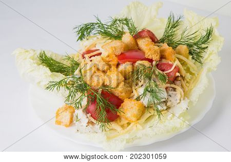 Cesar Salad With Greens On A White Plate