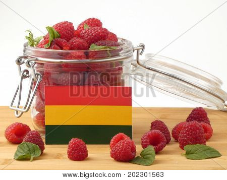 Bolivian Flag On A Wooden Panel With Raspberries Isolated On A White Background