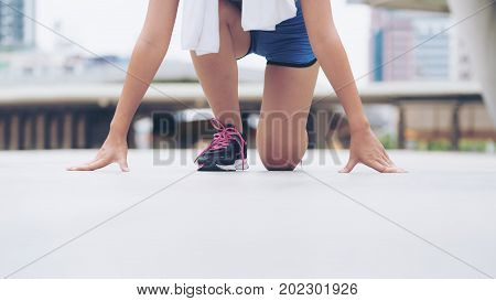 Woman Runner In Starting Running Position