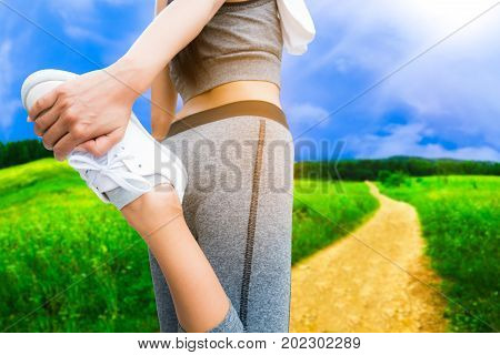 Sporty Woman Doing Leg Stretching