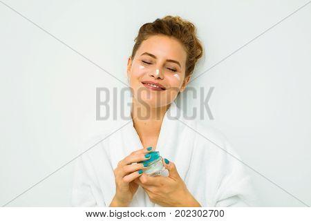 Woman In White Bath Towel Holding A Skin Cream