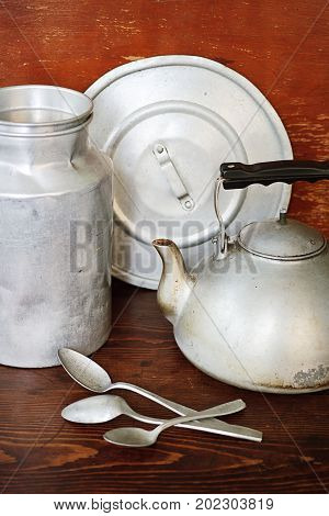Vintage aluminum crockery are milk can, kettle, spoons