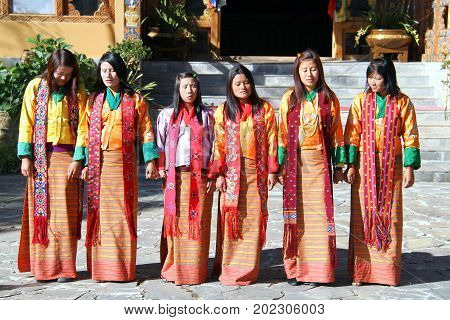 PARO BHUTAN - November10 2012 : Unidentified young singers and dancers in traditional Bhutanese dress singing and performs traditional dance. Paro Bhutan
