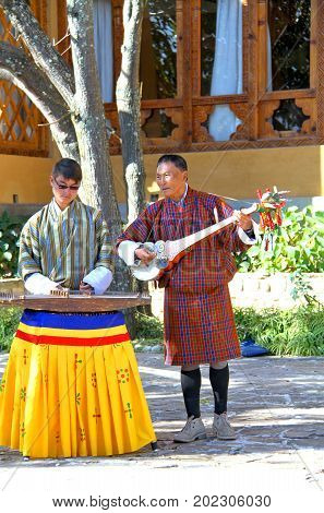 PARO BHUTAN - November10 2012 : Unidentified musicians in traditional dress (Gho) playing instruments at hotel in Paro Bhutan