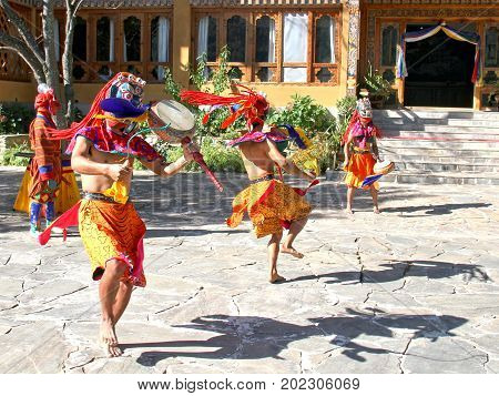 PARO BHUTAN - November10 2012 : Bhutanese dancers with colorful mask performs traditional dance at hotel in Paro Bhutan
