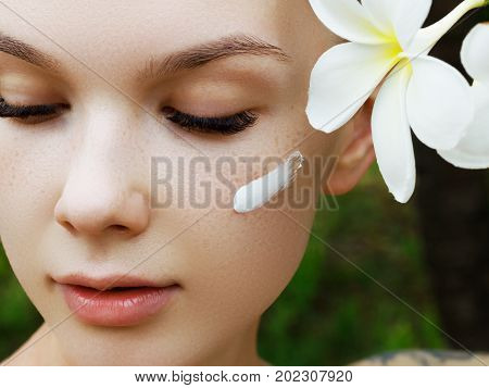 Joyful Girl With Freckles. The Concept Of A Healthy Skin. Portrait Of A Beautiful Girl Against A Bac