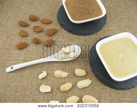 White and dark almond mus on a slate plate