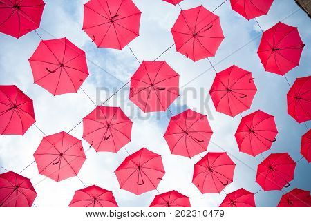 sky filled with red umbrellas as an art object