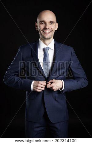 Cheerful Man Fastens His Jacket