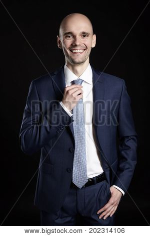 Smiling Man Holding His Tie