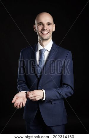 Cheerful Businessman Fixing Cuffs His Suit