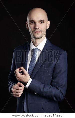 Businessman Fixing Cuffs His Button Down Shirt
