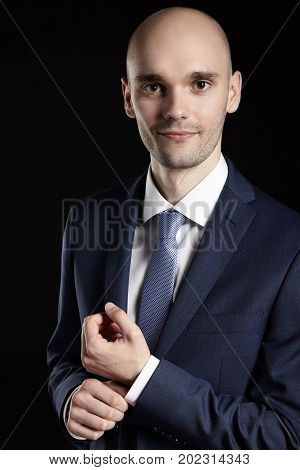 Businessman Fixing Sleeve His Suit