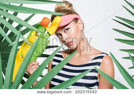 Fashionable Woman With Water Gun