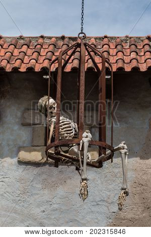 Parma, Italy - june 2015: Human Skeleton Toy with Pirate Bandanna in a Cage