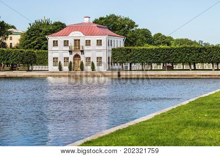 Saint Petersburg, Russia - July 08, 2017: the Marly Palace and ornamental ponds in the lower Park of Peterhof. The Peterhof Palace included in the UNESCO world heritage list