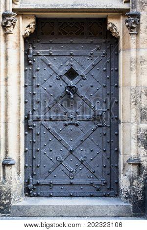 Medieval prison door in old european castle. Closed door forbidden to entrance