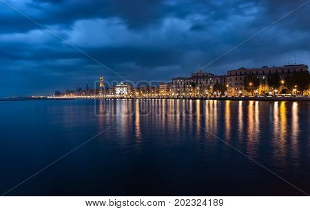 Bari italy night cityscape coastline from sea. Citylights at seafront after sunset