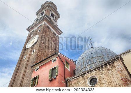 clock and cupola of church Santi Apostoli in Venezia