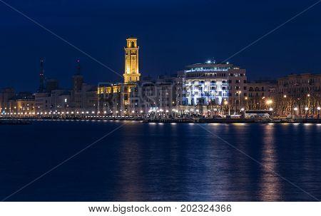 Bari seafront night Citylights cityscape. coastline at twilight