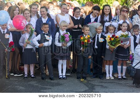Adygea Russia - September 1 2017: children with bouquets of flowers enrolled in the first class at school at the inauguration of the school year in the day of knowledge