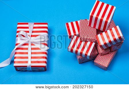 Hill red and white gifts on the blue background