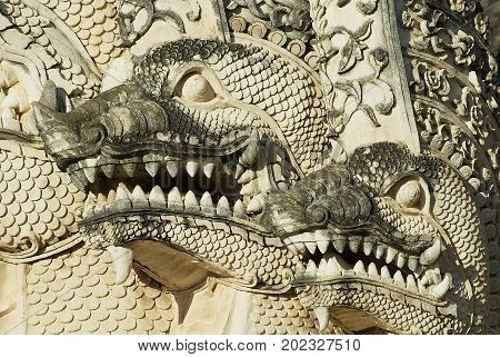 Architectural detail of the Naga (mythological Giant snake) at the 15th century Prasat temple in Chiang Mai, Thailand.