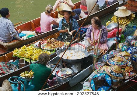 DAMNOEN SADUAK, THAILAND - MAY 15, 2008: Unidentified people sell food from boats at the floating market in Damnoen Saduak, Thailand.