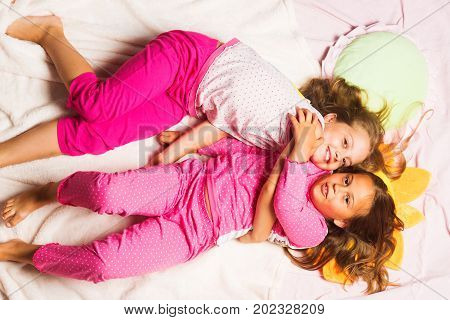 Schoolgirls Having Pajama Party. Kids In Pink Pajamas