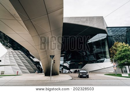 Munich, Germany - August 3, 2017: Exterior shot of BMW Welt in Munich. It is a multi-use exhibition center used for meetings and promotional events, and where buyers take delivery of BMW vehicles. Designed by archtectural firm Coop Himmelblau