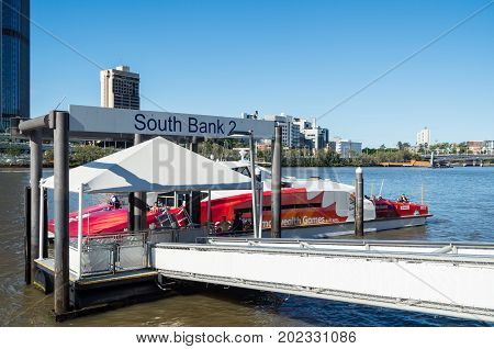 Brisbane, Australia - July 9, 2017: CityCat ferry docked at South Bank in central Brisbane. CityCats provide a regular ferry service along the Brisbane River.
