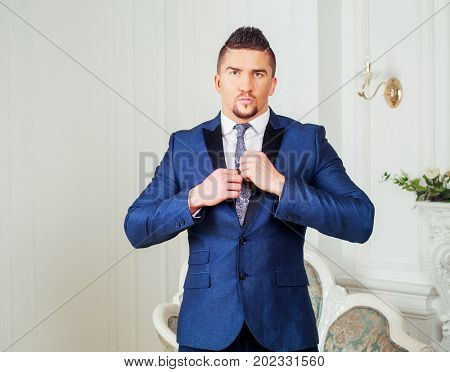 stylish man wearing a suit in the interior