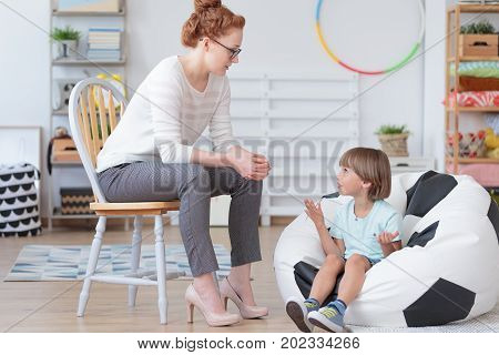 Young Boy Talking With Counselor