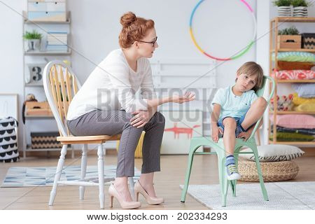 Counselor Talking With Worried Boy